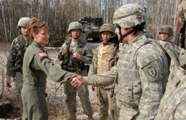 http://sarahpalininformation.files.wordpress.com/2009/02/sarah-in-fatigues-shaking-hands-with-military.jpg?w=575&h=371