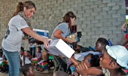Bristol and Sarah handing out Christmas packages to children in Haiti
