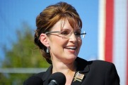 Closeup of Sarah at mike with flag pin