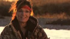 Closeup of Sarah in camo with red bandana on