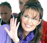 Closeup of Sarah in purple jacket waving at Governors Picnic