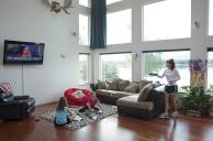 Palin adjusts TV in living room