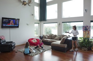 Palin adjusts TV in living room