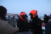 Palin and Quam shaking hands after finishing 2011 Iron Dog race