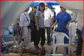 Sarah and Greta standing at entrance to tent in Haiti