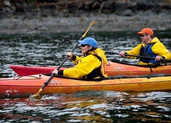 Sarah and Todd racing in kayaks