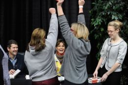 Sarah and Todd smile as girls show enthusiasm after getting their books signed in Anchorage