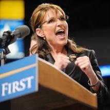 Sarah at podium revving up crowd