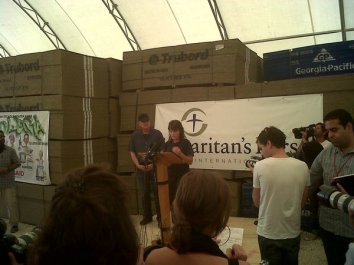 Sarah at podium with Graham during Samaritan's purse presser in Haiti