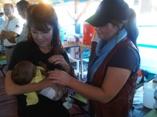 Sarah holding infant in cholera clinic - Bristol with her