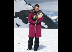 Sarah holds puppies on glacier