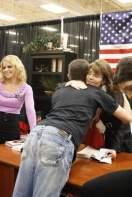 Sarah hugs young man at Cincinnati book signing