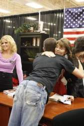 Sarah hugs young man at Cincinnati book signing