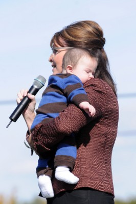 Sarah in New Hampshire in 2008 - holding Infant Trig and speaking into microphone
