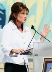 Sarah in white jacket at Restoring Honor Rally - gesturing