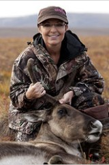 Sarah posing with caribou she shot on hunting trip