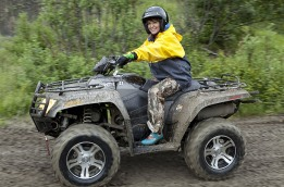 Sarah riding ATV when visiting gold mine