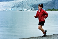 Sarah running in front of glacier