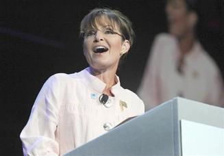 Sarah speaking at Gwinnett Arena - big screen in background