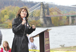 Sarah speaking in front of river in Wheeling VA