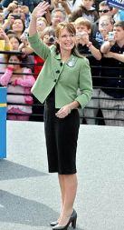 Sarah Waving in Green Jacket and Black Dress