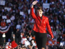 Sarah Waving in Red Leather Jacket