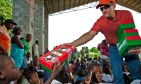 Todd handing out shoebox Christmas packages to Haitian children