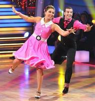 Bristol and Mark doing jive at DWTS - Bristol in pink Fifties outfit