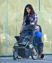 Bristol guides stroller while Tripp pushes