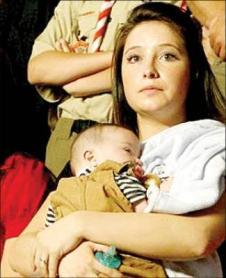 Bristol holding infant Tripp with towel over her shoulder
