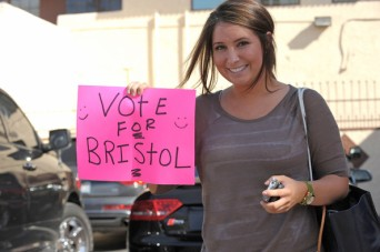 Bristol holds up Vote For Bristol Sign in Los Angeles