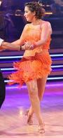 Bristol in orange outfit doing the mamba on DWTS