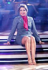 Bristol in tearabway conservative suit at beginning of cha cha cha on DWTS