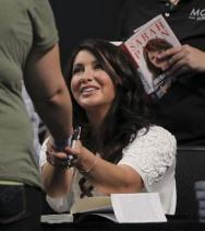 Bristol shaking ladys hand at her book signing at MOA - June 29 2011