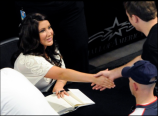 Bristol shaking man's hand as she signs his book at MOA book signing