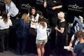 Bristol talking to young girls at MOA book signing