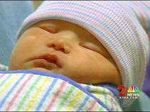 Closeup of Infant Trig in Cap in Blanket