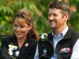 Closeup of Sarah and Todd Smiling at Farewell Speech