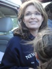 Closeup of Sarah in blue New Hampshire sweatshirt a clambake in Portsmouth