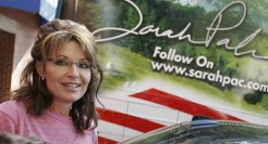Closeup of Sarah next to signature on One Nation bus