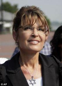 Closeup of Sarah wearing Star of David necklace