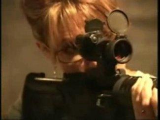 Closeup of Sarah with M-16