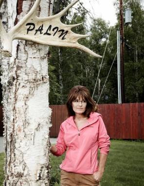 Newsweek Photo Shoot - Sarah posing beneath Palin antler sign