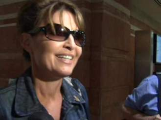 Palin at Sky Harbor Airport in AZ on Friday after first week of One Nation bus tour