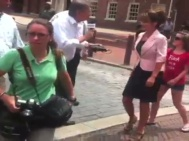 Piper about to react as reporter approaches Sarah in Philly