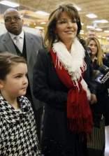 Piper and Sarah as Sarah speaks to reporters at Cincinnati OH book signing