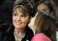 Piper Whispering to Sarah at Governor Perry Rally in Cypress Texas