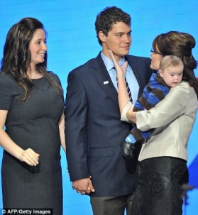 Sarah affectionately touching Levi's cheek at RNC