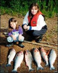 Sarah and daughter with fish