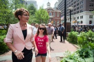 Sarah and Piper and the Heaths walk in historic district in Philadelphia